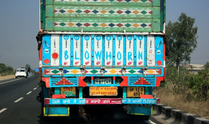 Graffiti at the back of a truck in India; truck painting; truck pictures