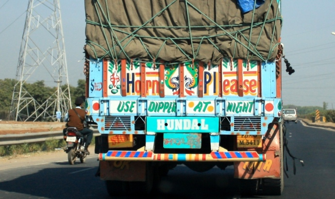 Graffiti at the back of trucks in india; truck painting; pictures on truck's body